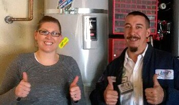 Image of Rapid Rooter Plumbing Plumber with customer after water heater install.